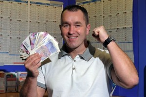 Delighted-Ryan-shows-off-some-of-his-winnings-after-Corals-climbdown-2788988-300x200
