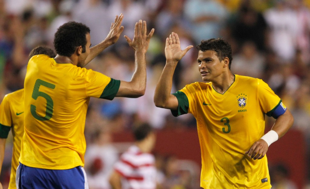 LANDOVER, MD - MAY 30: Thiago Silva #3 of Brazil celebrates scoring a goal with teammate Sandro #5 against USA during an International friendly game at FedExField on May 30, 2012 in Landover, Maryland. (Photo by Rob Carr/Getty Images)
